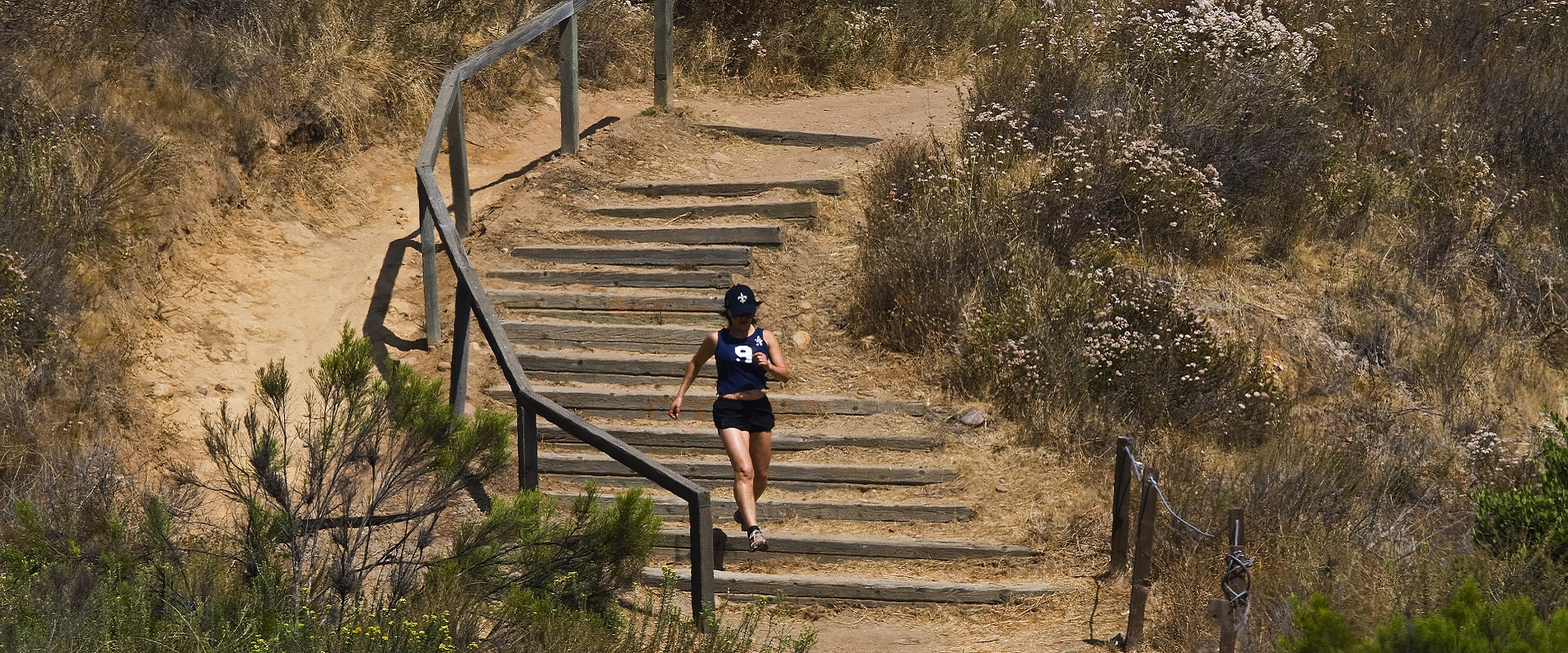 Woman running a trail at Balboa Park