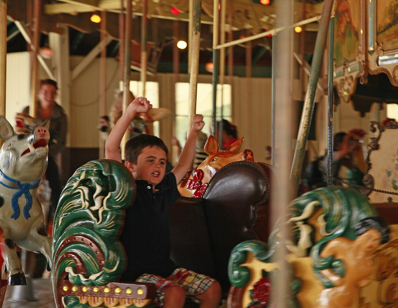 Boy riding the Balboa Park Carousel