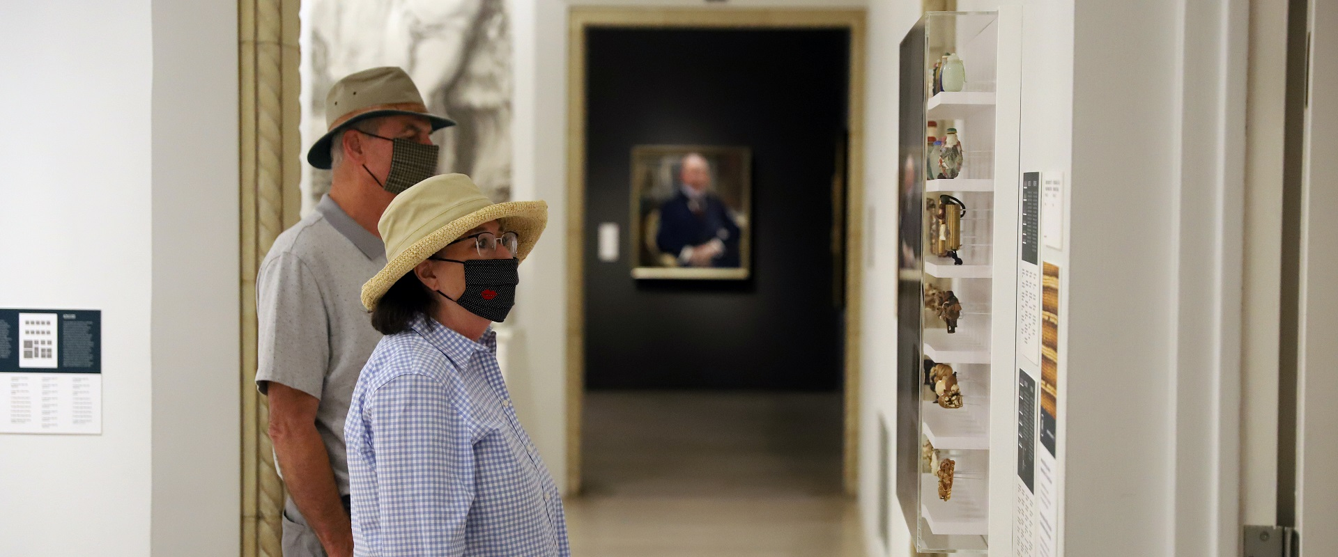 San Diego Museum of Art visitors wearing masks while looking at art work