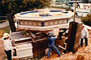 Workers moving the Woman of Tehuantepec fountain at Balboa Park